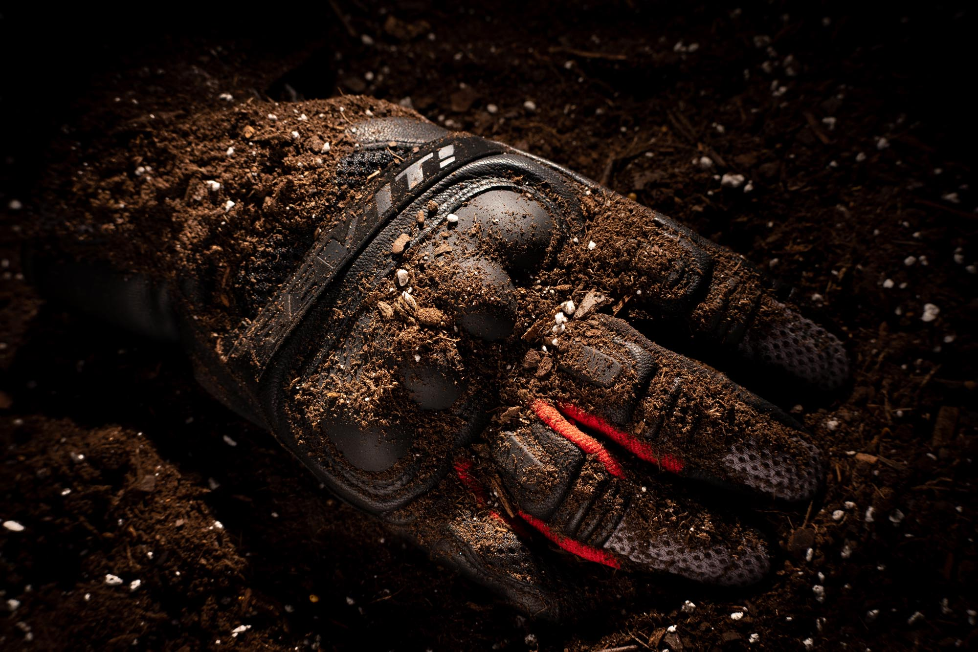 REV'IT Dirt 3 gloves covered in dirt