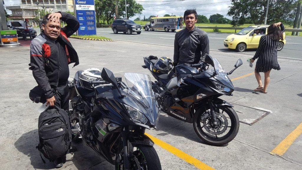 bikers posing with kawasaki bikes