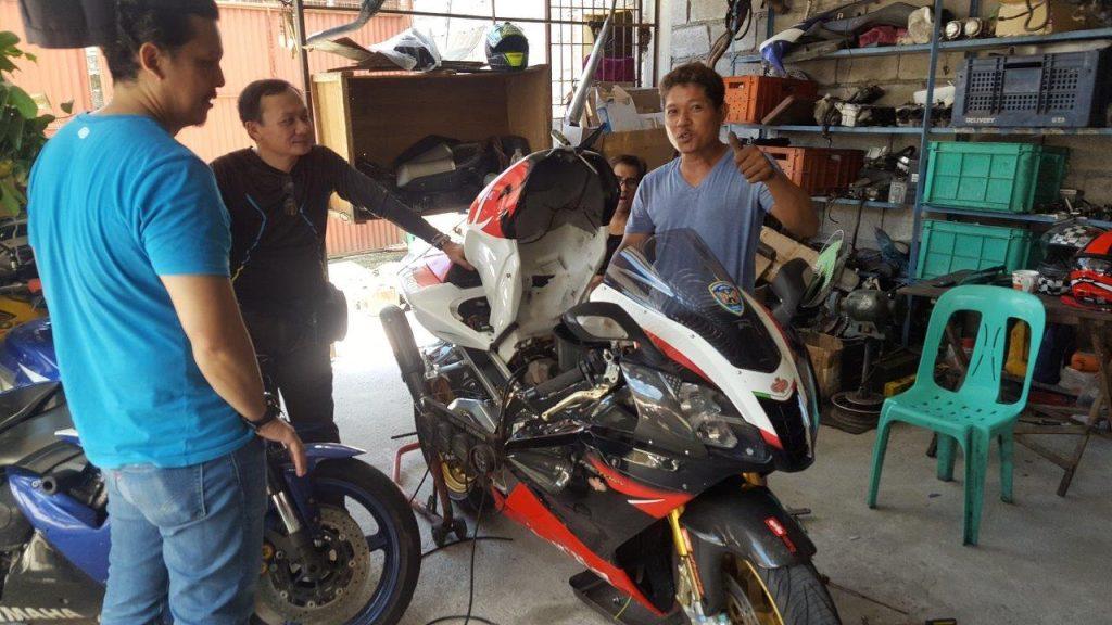 Mechanics working on Aprilia bike