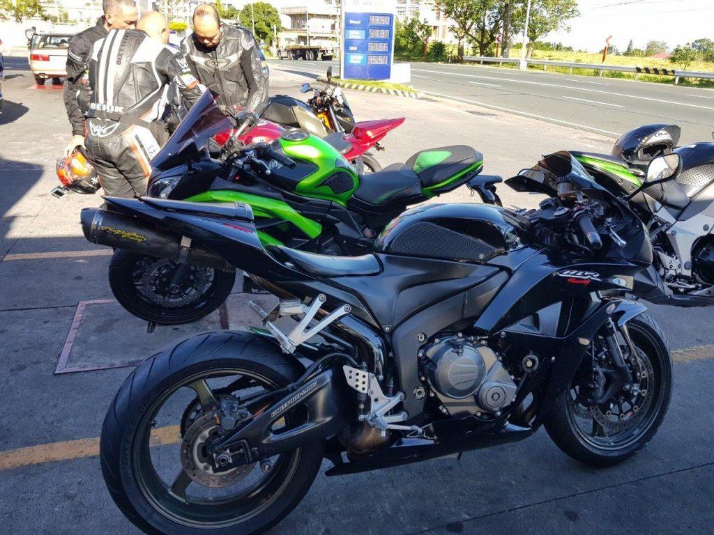 Honda bike parked at gas station