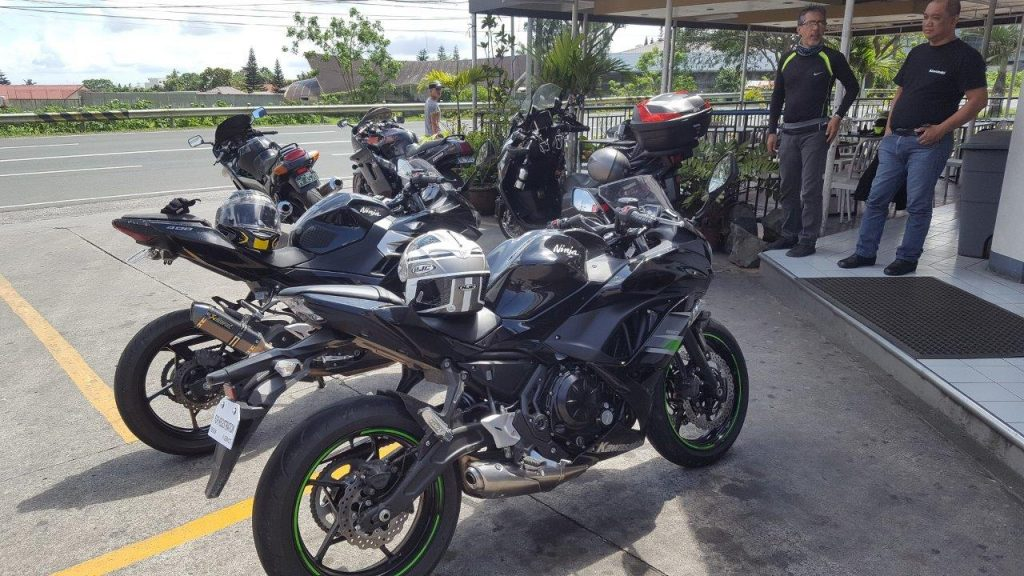Kawasaki owners admiring their bikes