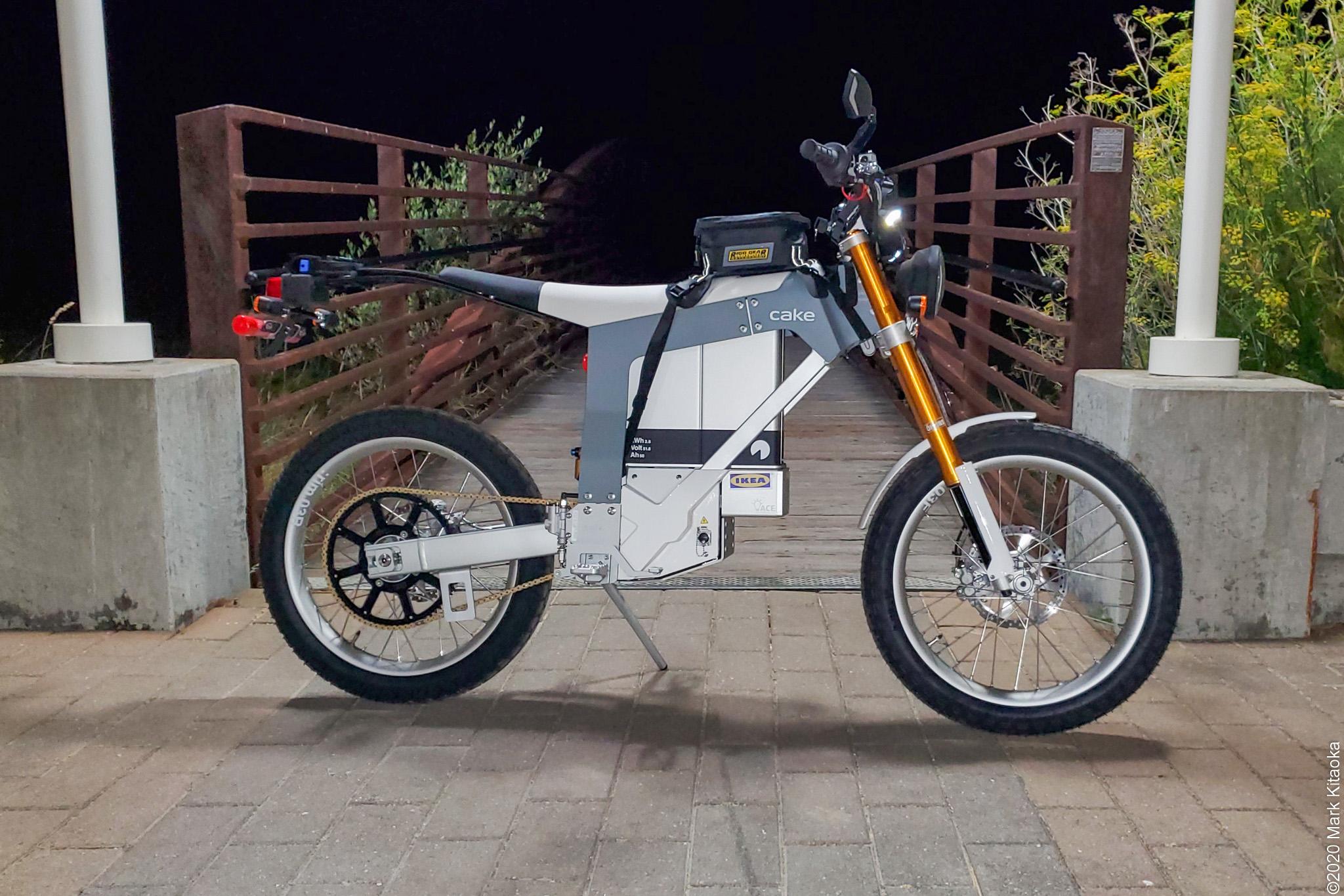 Kalk motorcycle in front of bridge