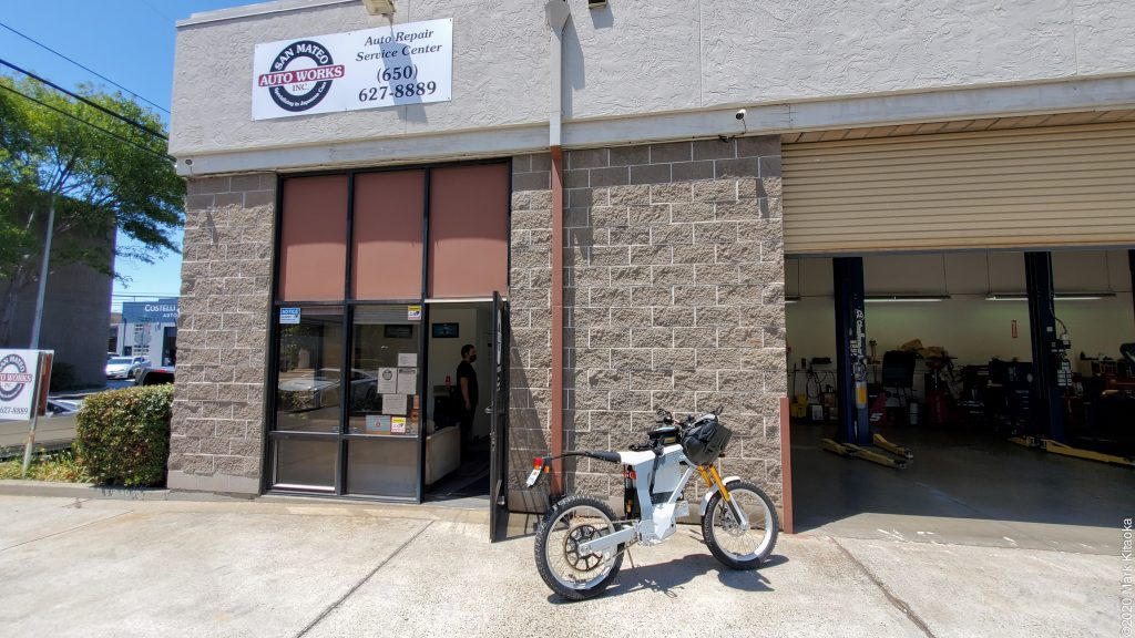 Kalk motorcycle in front of auto repair shop