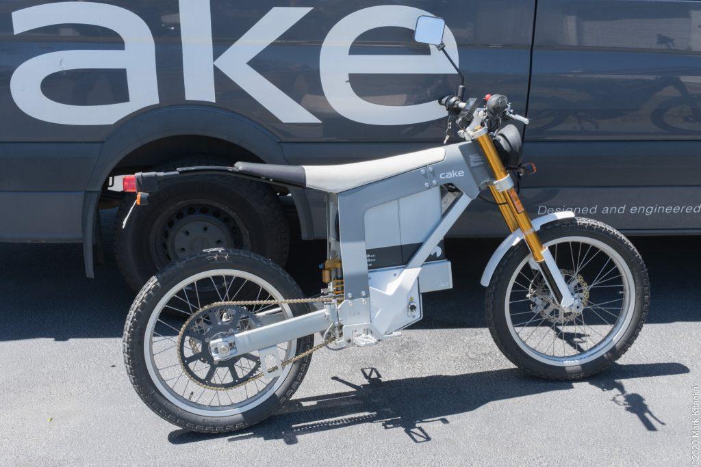Kake motorcycle in front of van