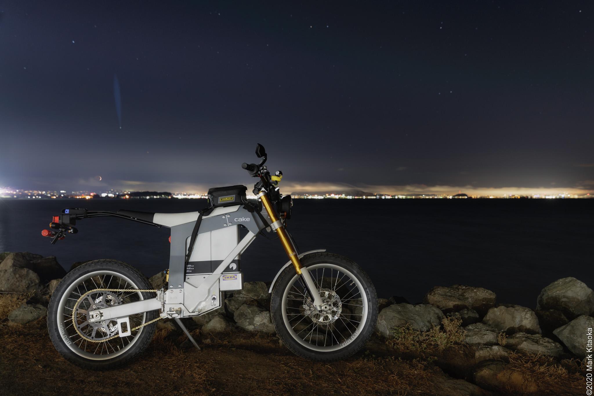 Kalk motorcycle next to ocean at night