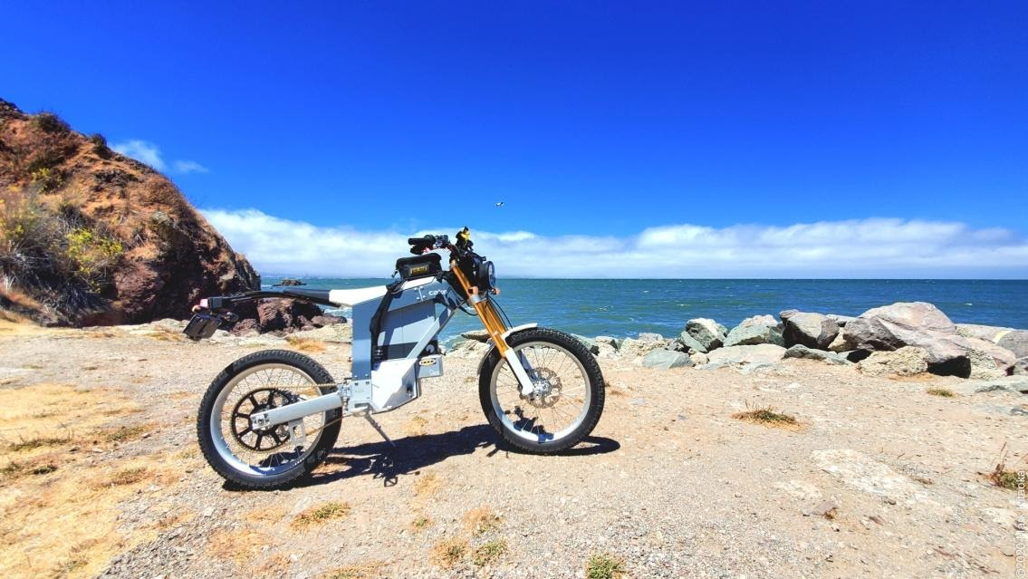 Kalk motorcycle next to ocean