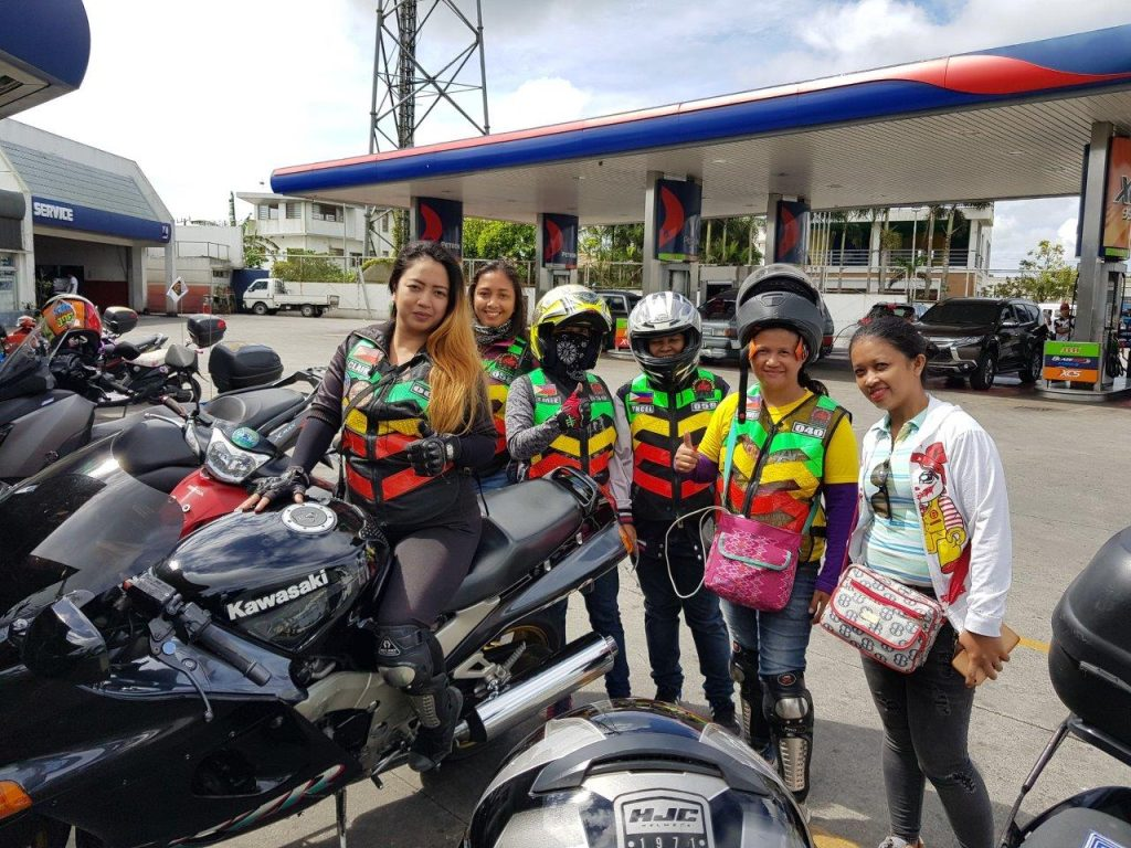 a group of lady bikers posing for a picture