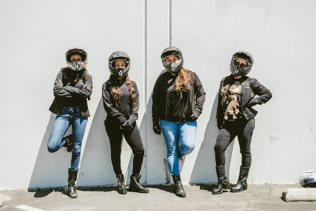 four women in motorcycle gear
