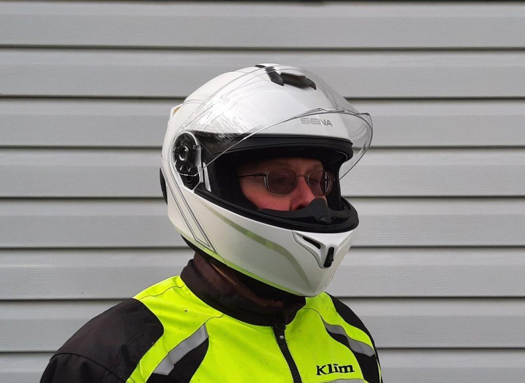 Rider wearing Sena Outrush Modular Helmet