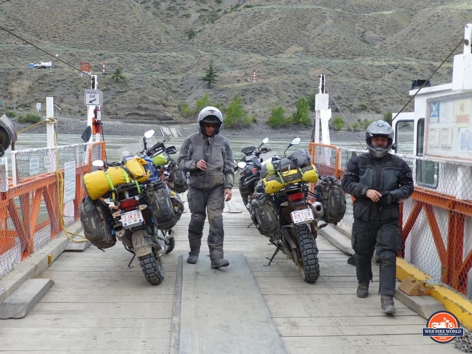 Riders on a reaction ferry with motorcycles near 100 Mile House, Alberta.