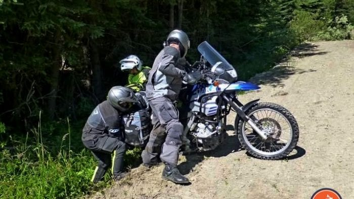 Jim Pruner and friends working together to get a bike out of the ditch.