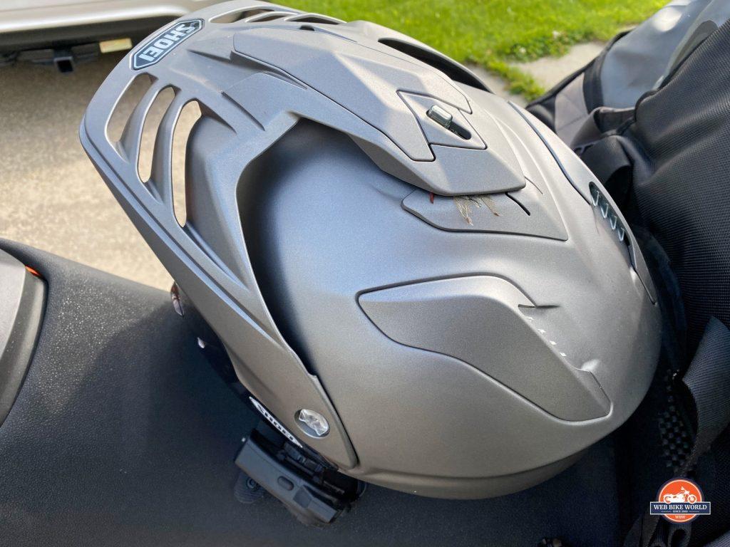 Shoei Hornet X2 helmet with bug stuck to top vent.