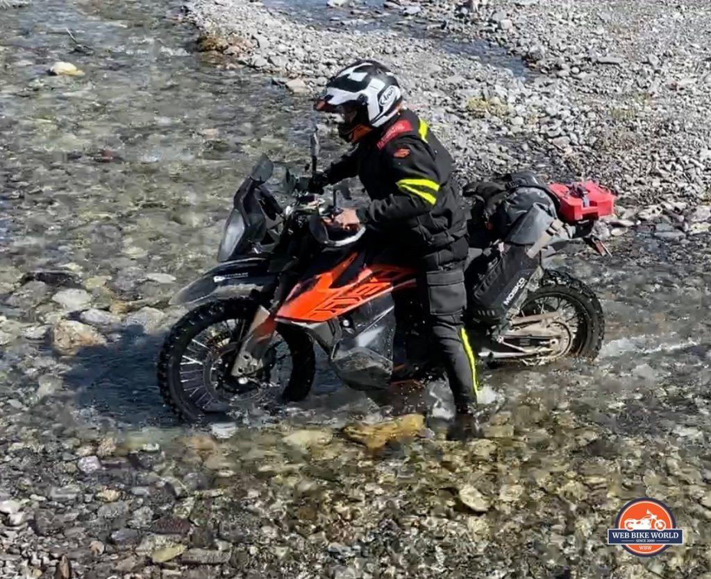 Jim Pruner crossing a stream on his KTM 790 Adventure.