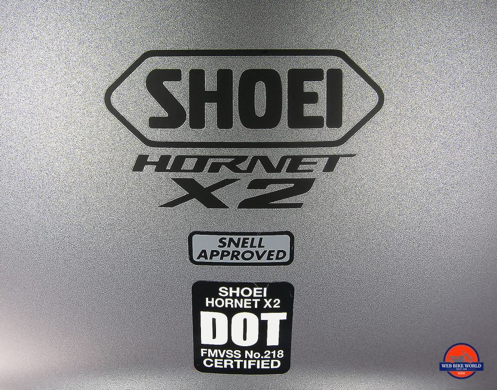 The Snell and DOT stickers on the back of the Shoei Hornet X2.