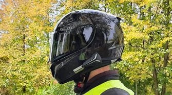 Side view of rider wearing RPHA 11 Pro Carbon helmet