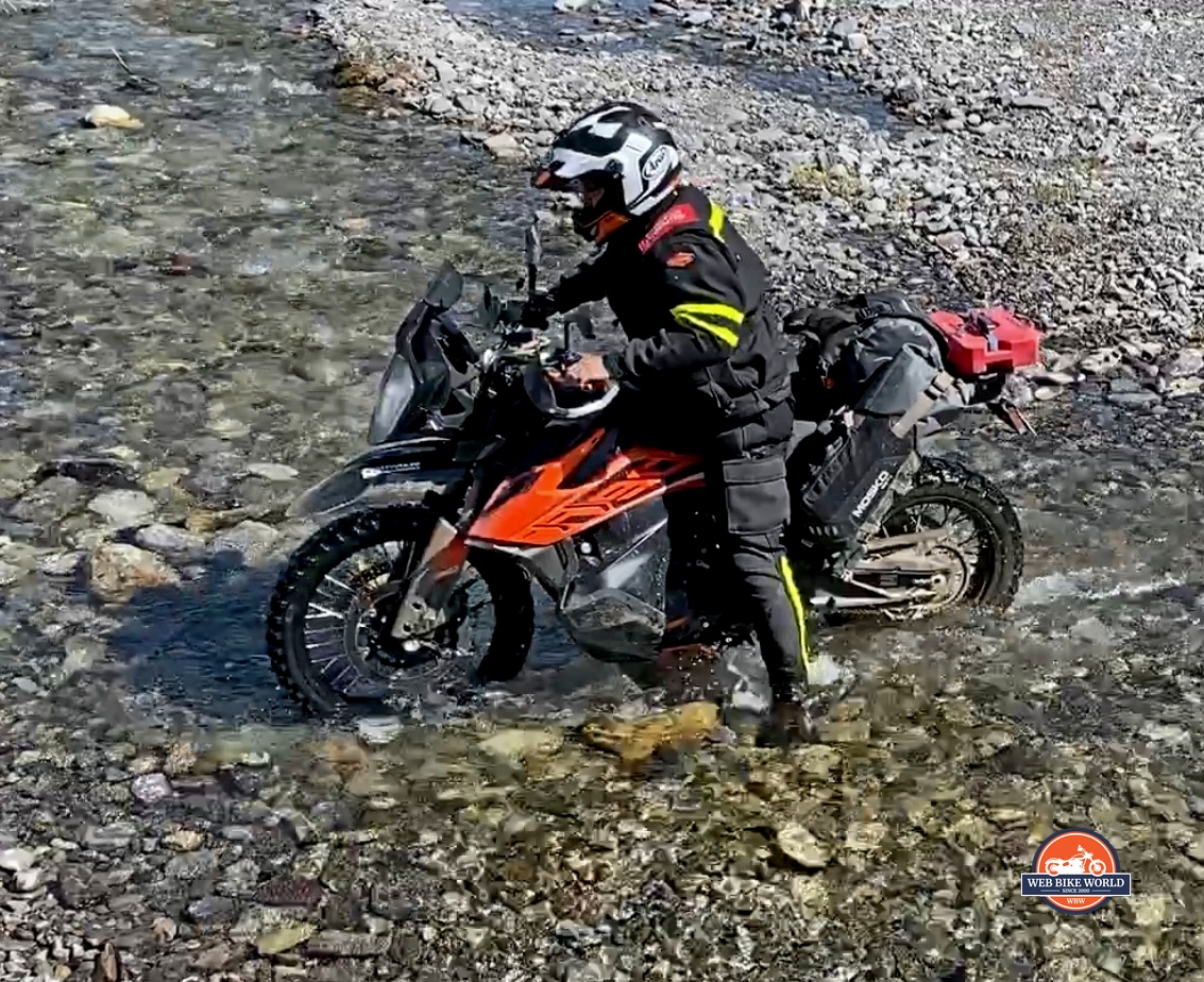 Jim Pruner crossing a stream on a KTM 790 Adventure while wearing the Joe Rocket Canada Whistler Adventure boots.