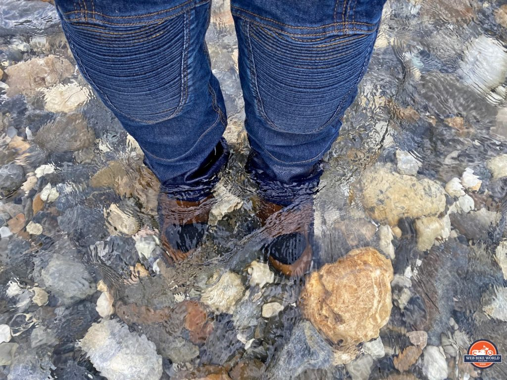 The Joe Rocket Canada Whistler Adventure boots submerged in a stream.