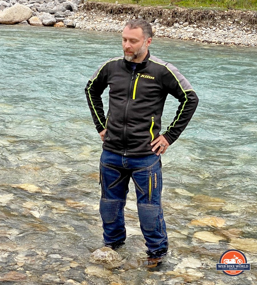 Jim Pruner standing in a stream while wearing the Joe Rocket Canada Whistler Adventure boots.