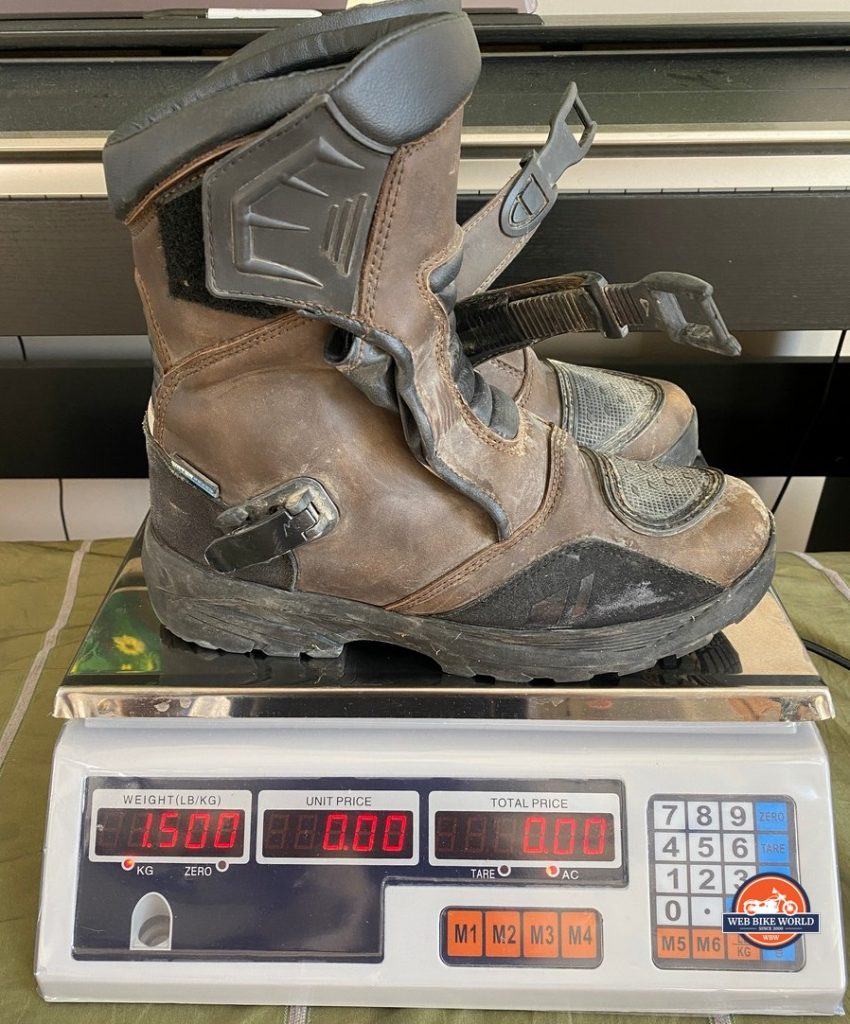 The Joe Rocket Canada Whistler Adventure boots weighing 3.3lbs on a scale.