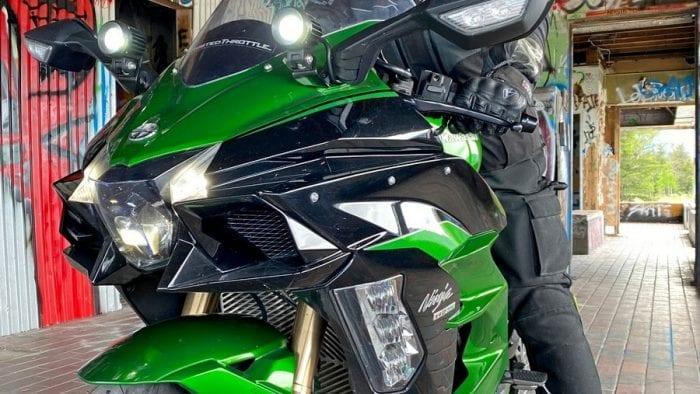 The Klim Krios Pro being worn by a rider on a Kawasaki Ninja H2SX SE.
