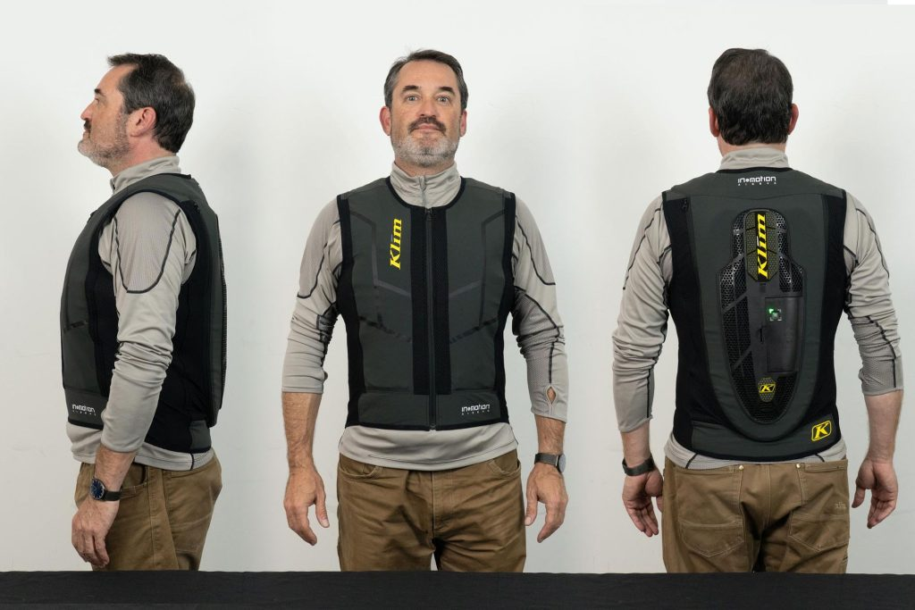 Front, side, and rear view of user wearing Klim Ai-1 airbag vest