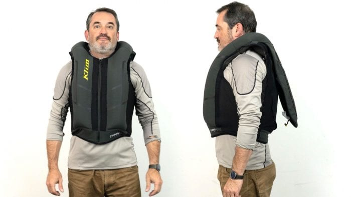 Front and side view of user wearing inflated Klim Ai-1 airbag vest