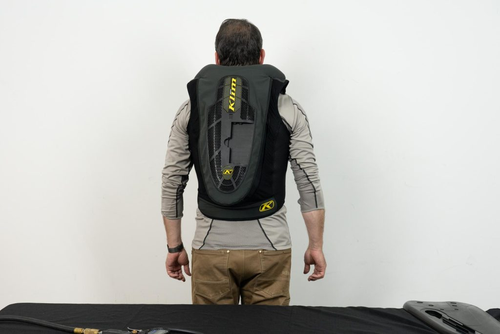 Rear view of individual wearing an inflated Klim Ai-1 airbag vest