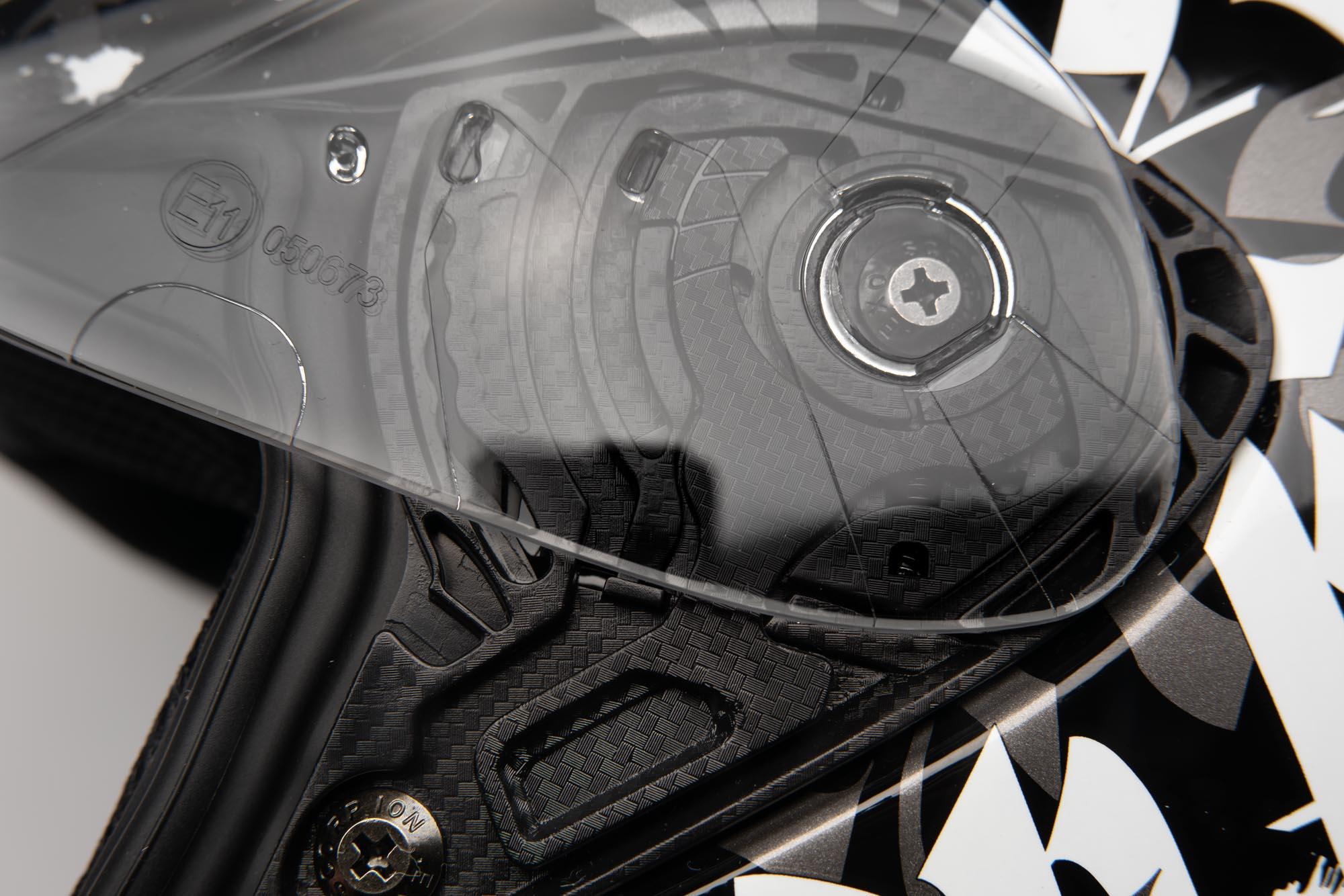 Closeup of the EllipTec™ II quick-release mechanism at the visor pivot.