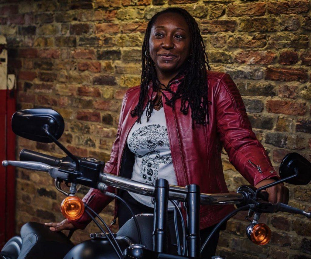 Female rider wearing MotoGirl Valerie jacket