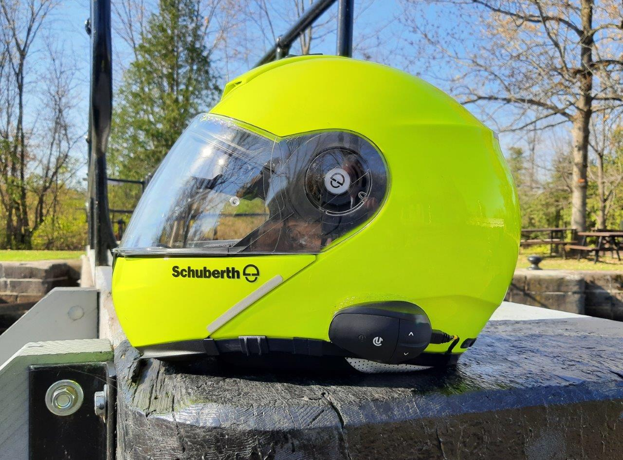 UClear AMPGo2 mounted on side of Schuberth C3 Pro helmet