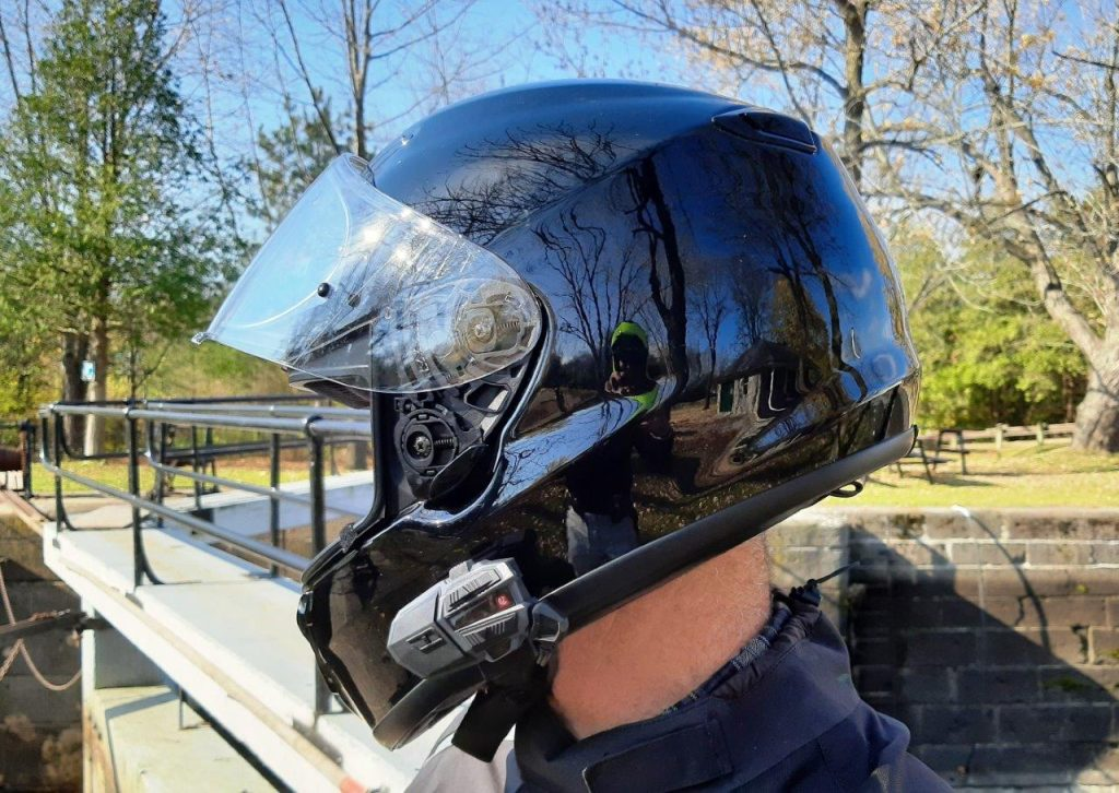 Rider wearing Shoei helmet with UClear Motion 4 Life attached