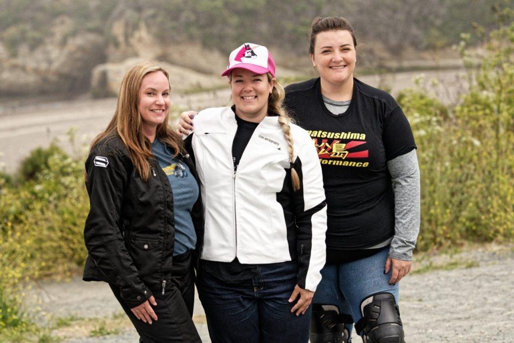 Female riders wearing motorcycle gear