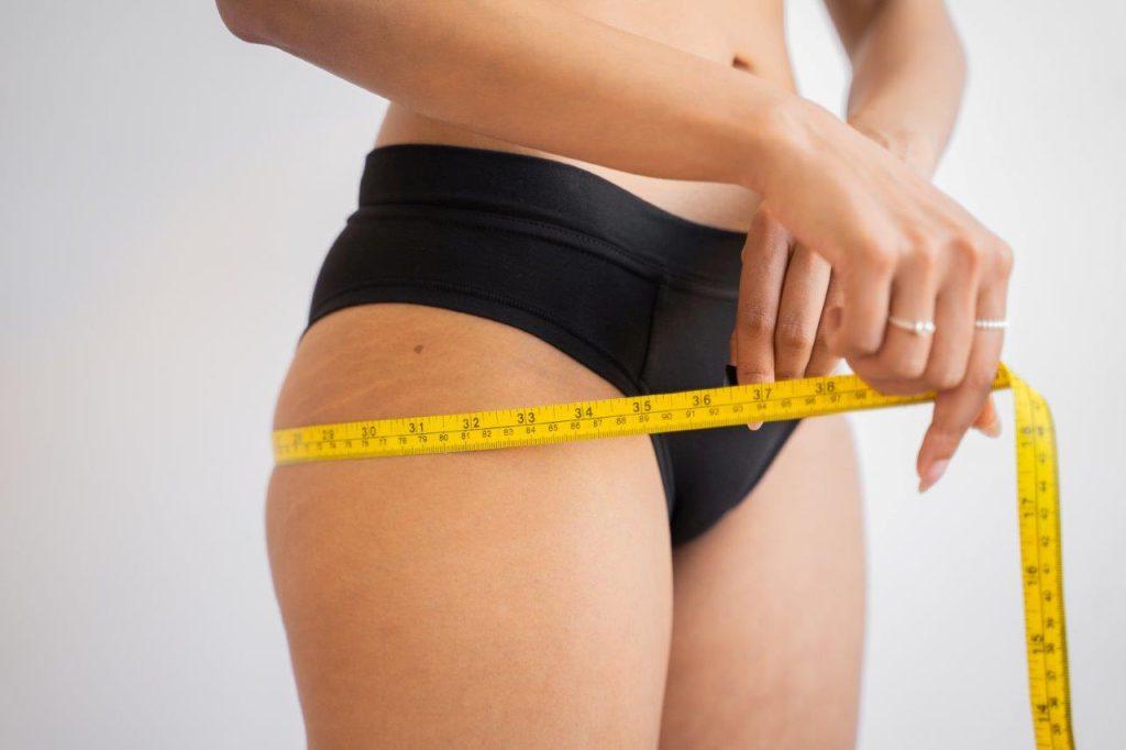 Female measuring her hips