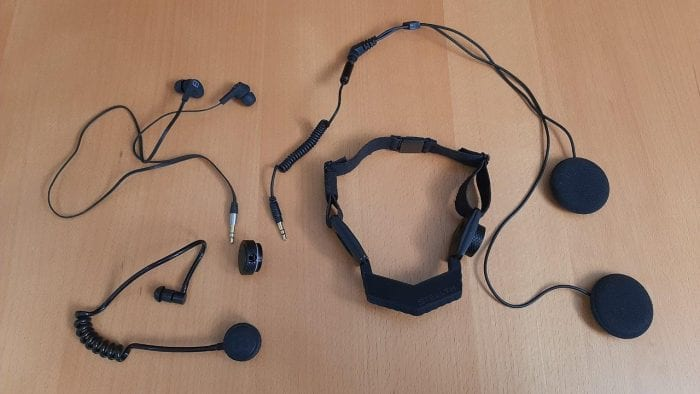 iASUS Stealth Throat microphone laid out on table