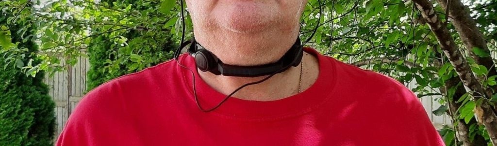 Rider wearing iASUS Stealth Throat microphone