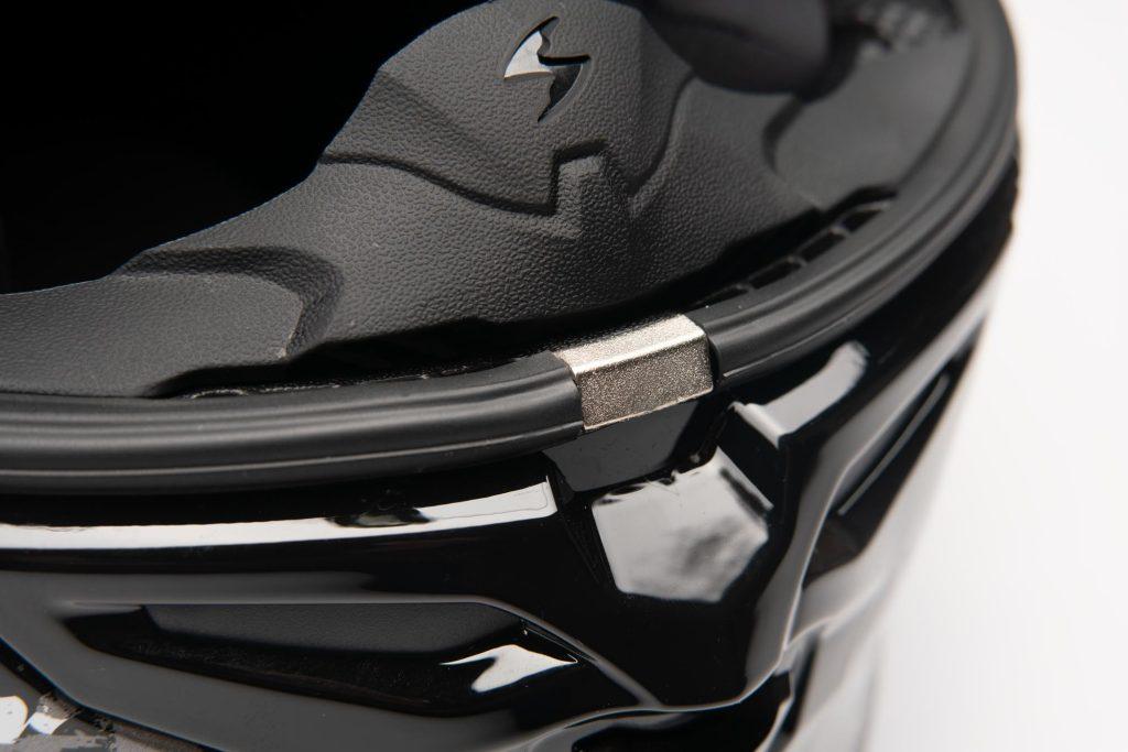 Location of where the visor clips locks the visor in closed position