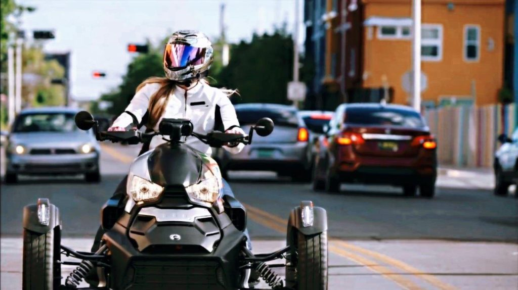 Rider on Can-Am Ryker 900 Rally Edition in city streets