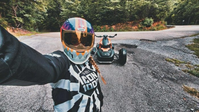 Brittany Morrow taking a selfie with the parked Can-Am Ryker 900 Rally Edition