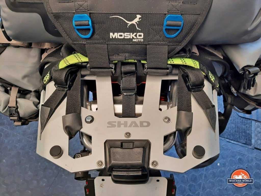 The Mosko Moto Reckless 80L v3.0 Revolver luggage strapped to a Shad cargo rack on a BMW F850GS Adventure motorcycle.