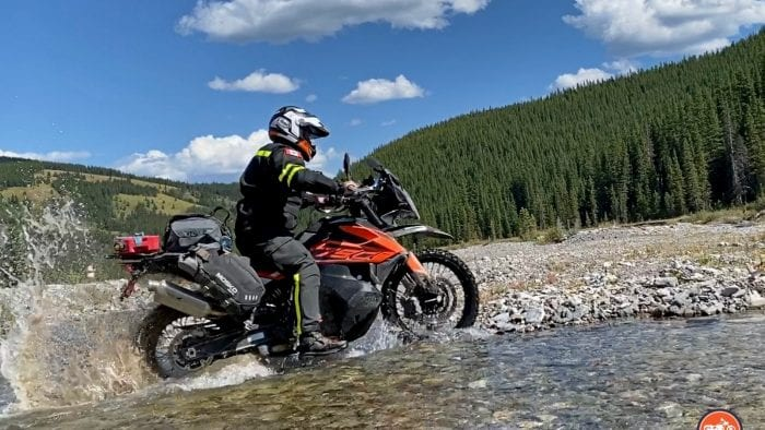 A KTM 790 adventure crossing a stream.