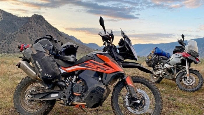 The Mosko Moto Reckless 80L V3.0 on a KTM 790 Adventure with a BMW R1200GS in the background.