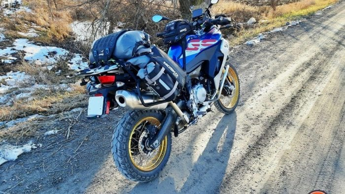 A 2020 BMW F850GS Adventure parked on a country road with the Mosko Moto Reckless 80L v3.0 Revolver luggage installed.