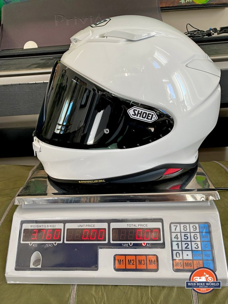 The Shoei RF-1400 on a scale showing 3.76lbs.