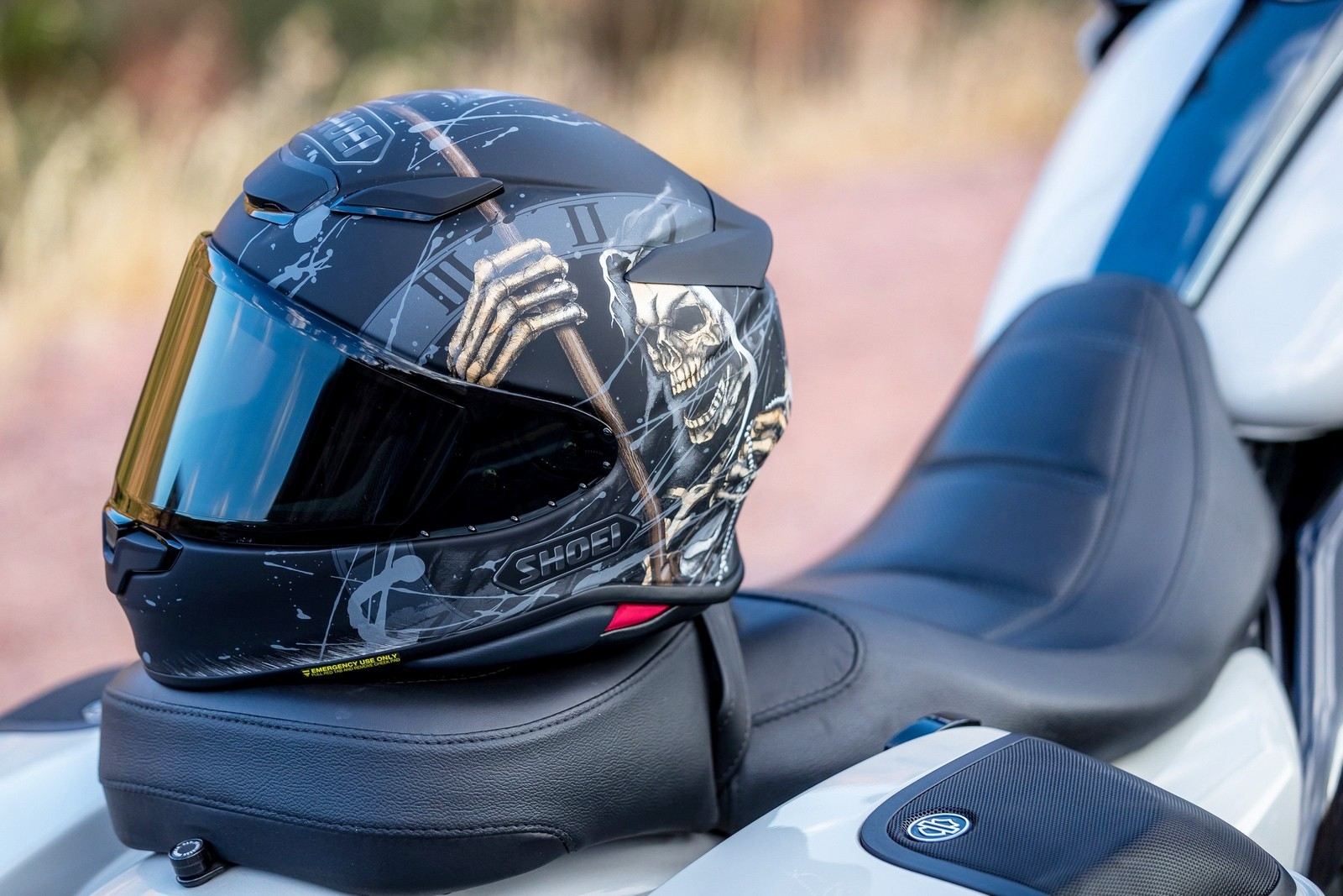 The new Shoei RF-1400 helmet sitting on a Harley Davidson seat.