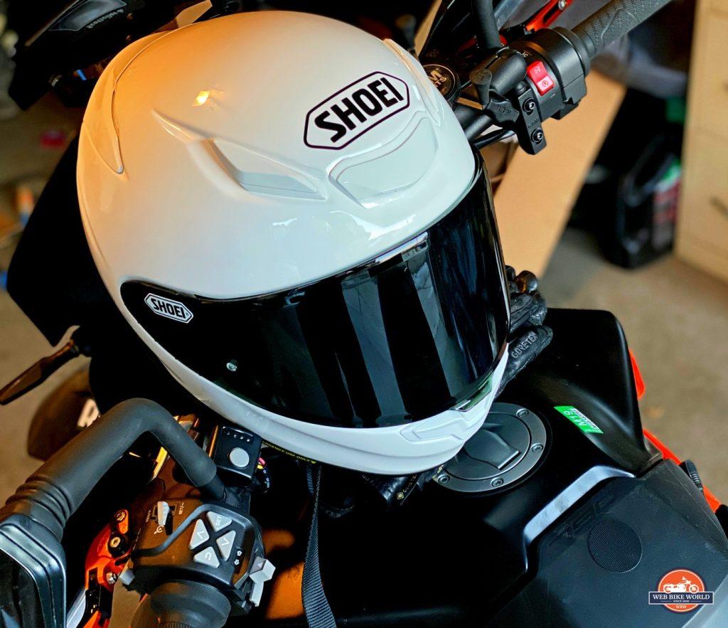The Shoei RF-1400 helmet sitting on a KTM 790 Adventure.