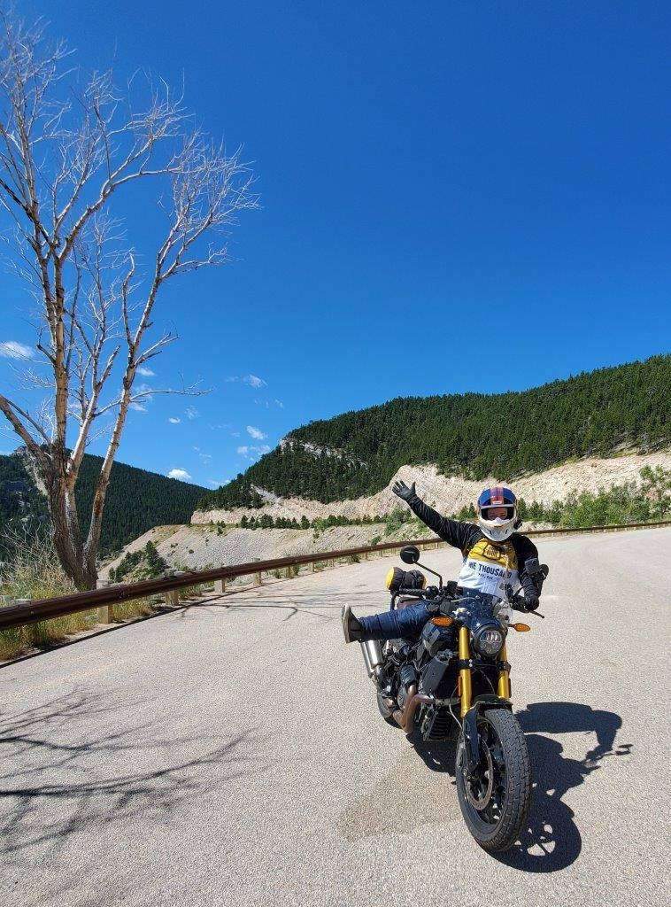 Indian FTR 1200 S with Touring Accessory package on a cliff edge in the Bighorn National Forest, Wyoming
