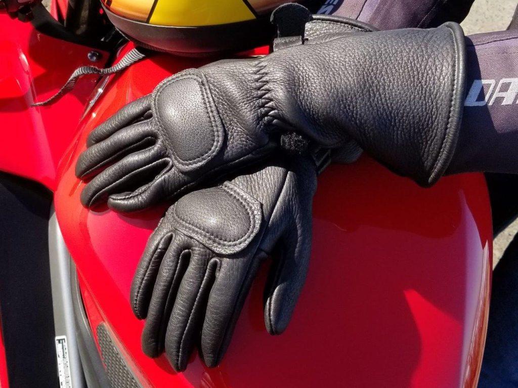 The Lee Parks Design Deersports gloves sitting on a Honda VFR800 gas tank.