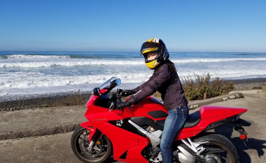 Me riding my Honda VFR800 by the Pacific Ocean.