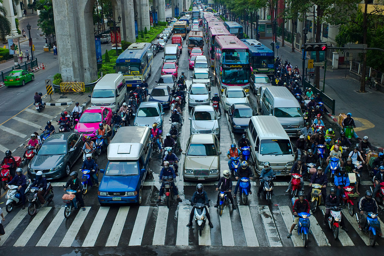 Motorcyclists lane filtering in Bangkok, Thailand