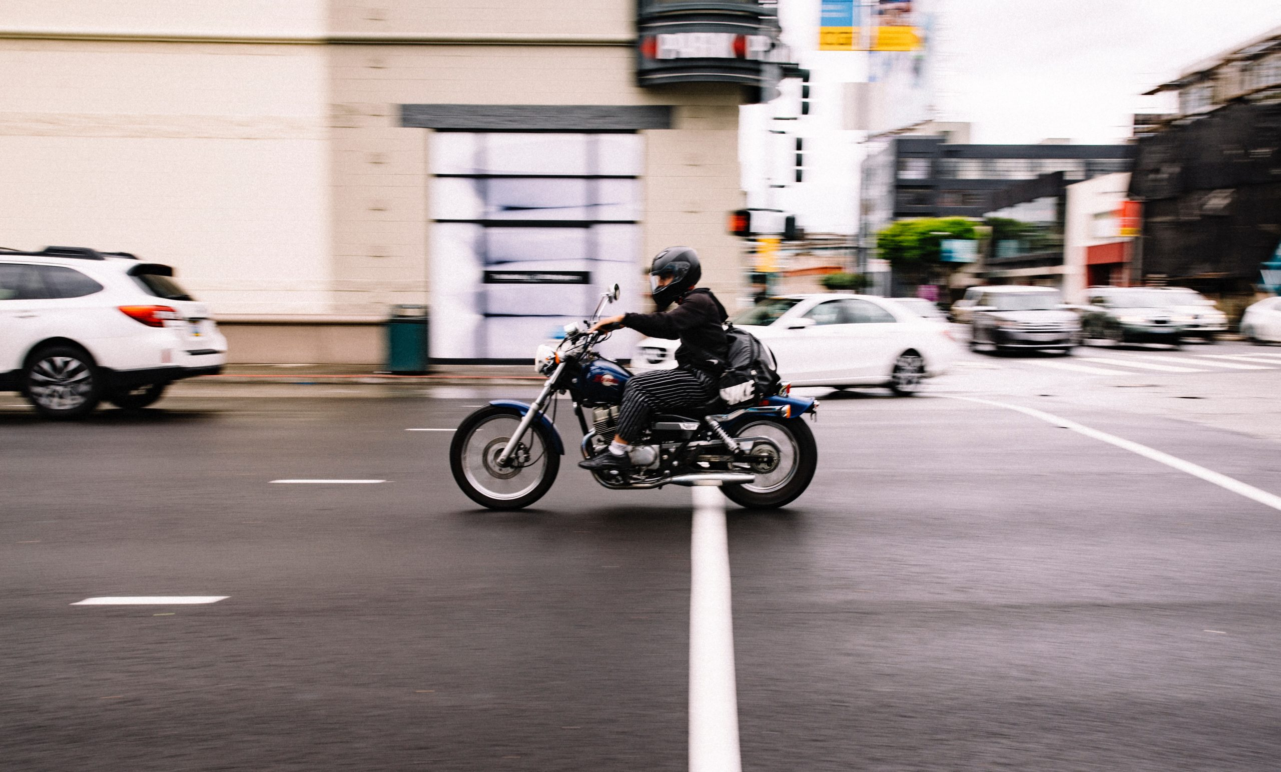man riding motorcycle on city roads
